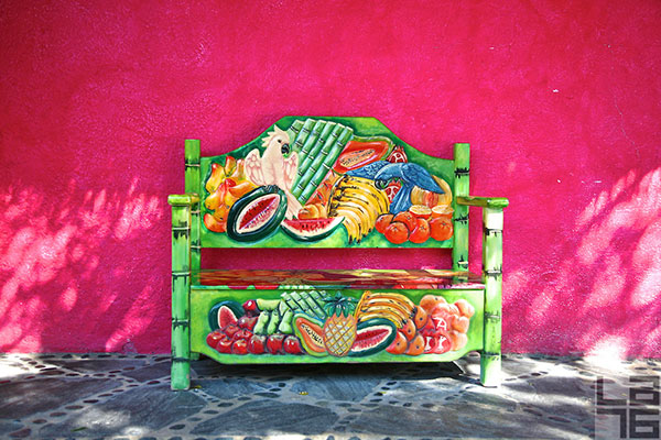 Pink-wall-and-a-colorful-fruit-bench-in-Cabo-San-Lucas-Mexico-08