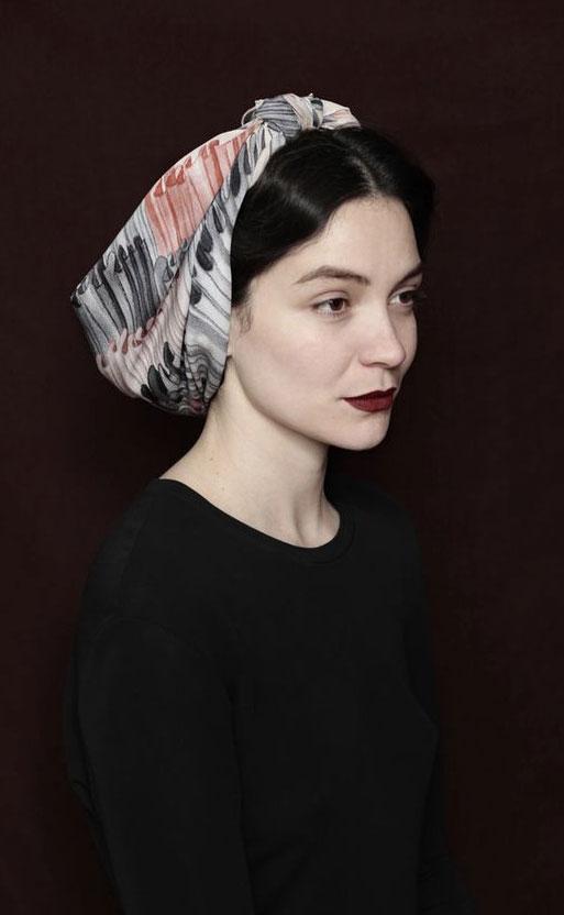 Andrea Pimentel modeling a SuTurno scarf