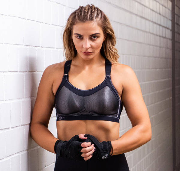 Christina Hammer, the current WBO & WBC Middleweight World Champion wearing Momentum Pro Sports Bra. Featured on Lingerie Briefs