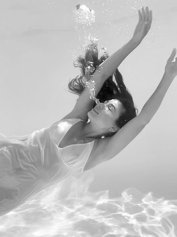 Kristina Eugenia in her underwater film for Christine Lingerie as featured on Lingerie Briefs